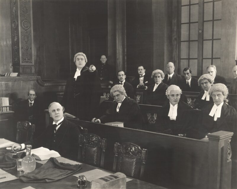 Barristers in wigs at a court case in the 20th century